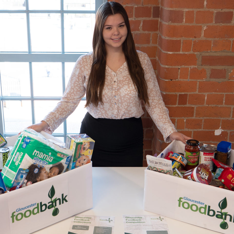 Kayleigh Jenner - Collecting for Gloucester Foodbank as part of our Social Responsibility