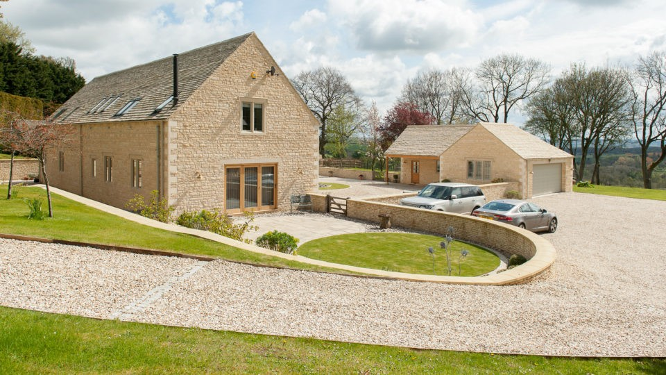 Woodland Court with sweeping gravel drive