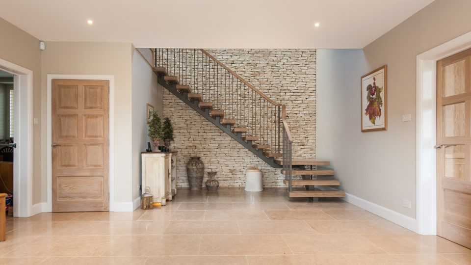 Reception area viewing bespoke staircase